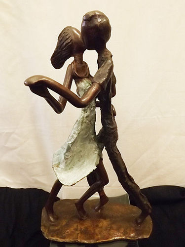 "Bronze ""getting down couple"" figurine"