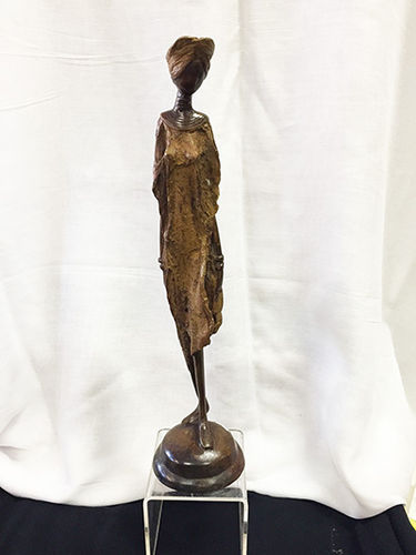 "Bronze ""styling and profiling"" figurine"