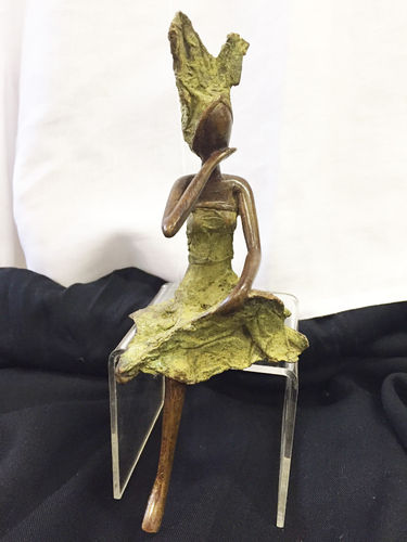 "Bronze ""taking a break"" figurine"