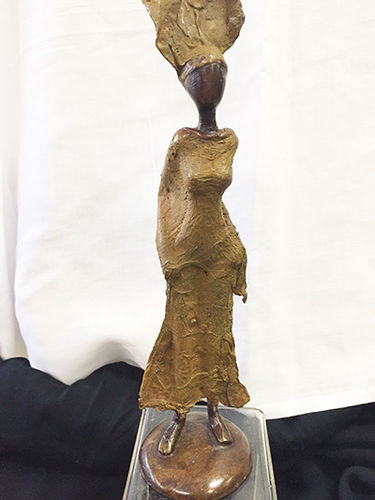"Bronze ""walking like you know it"" figurine"